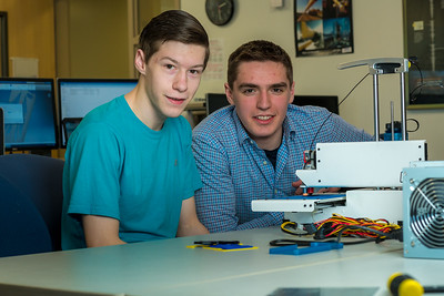 Stephen Ramirez, left, and Daniel Dougherty watch the progress on their project during an open work session in UAF's Community and Technical College's 3-D print lab in downtown Fairbanks.  Filename: AAR-16-4857-022.jpg