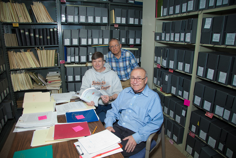 """Native linguists Jim Kari, front, Edward Vajda, center and Larry Kaplan pose with a recently published volume outlining research which establishes an ancient language connection between people of Asia and North America.  <div class=""""ss-paypal-button"""">Filename: AAR-12-3336-29.jpg</div><div class=""""ss-paypal-button-end"""" style=""""""""></div>"""