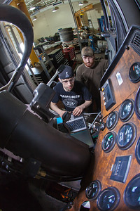 Jordan Young, front, and Seth Philbert run diagnostics on a big truck in the diesel mechanics lab at the Hutchison Institute of Technology.  Filename: AAR-12-3312-172.jpg