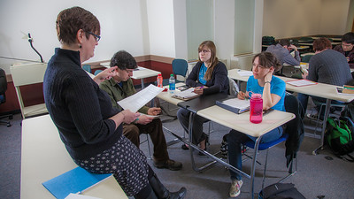 Professor Alexandra Fitts works with small groups of students in her Hispanic Theater class during a recent meeting in the Gruening Building.  Filename: AAR-12-3350-53.jpg