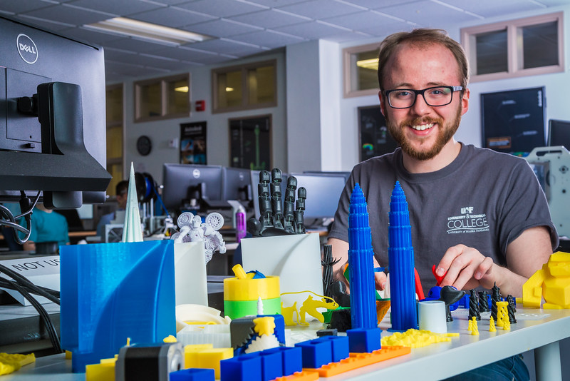 "Program lab assistant Joel Sturm displays a few of the items he's helped create at UAF's Community and Technical College's 3-D print lab in downtown Fairbanks.  <div class=""ss-paypal-button"">Filename: AAR-16-4857-154.jpg</div><div class=""ss-paypal-button-end""></div>"