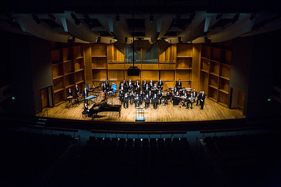 The UAF Wind Symphony poses for a picture during their pre-concert warmup on Nov. 18, 2016.  Filename: AAR-16-5070-6.jpg