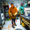 "Research Assistant Professor Jessica Larsen, at right, operates the valve while volcanology graduate student Rebecca deGraffenreid uses water to cool down a rod which contains volcanic remnants after it was pulled from a furnace in the Reichardt Building petrology lab.  <div class=""ss-paypal-button"">Filename: AAR-16-4828-088.jpg</div><div class=""ss-paypal-button-end""></div>"