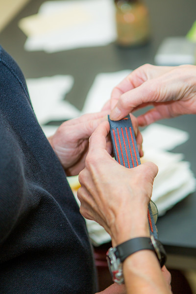 """Students work on their projects in a custom book binding workshop offered by UAF Summer Sessions during Wintermester 2013.  <div class=""""ss-paypal-button"""">Filename: AAR-13-3706-31.jpg</div><div class=""""ss-paypal-button-end"""" style=""""""""></div>"""