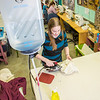 """Assistant professor Bethany Marx works on some of the finer details of the costumes she designed for Theatre UAF's spring 2014 production of """"Tartuffe.""""  <div class=""""ss-paypal-button"""">Filename: AAR-14-4104-246.jpg</div><div class=""""ss-paypal-button-end"""" style=""""""""></div>"""