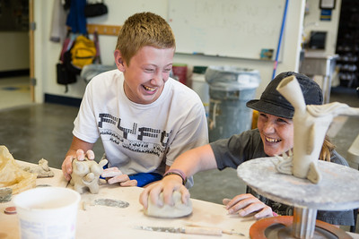 Arthur Hermanns (left) and Rhys Swingle create works of art from clay during ceramics class at UAF's Visual Arts Academy.  Filename: AAR-12-3430-36.jpg