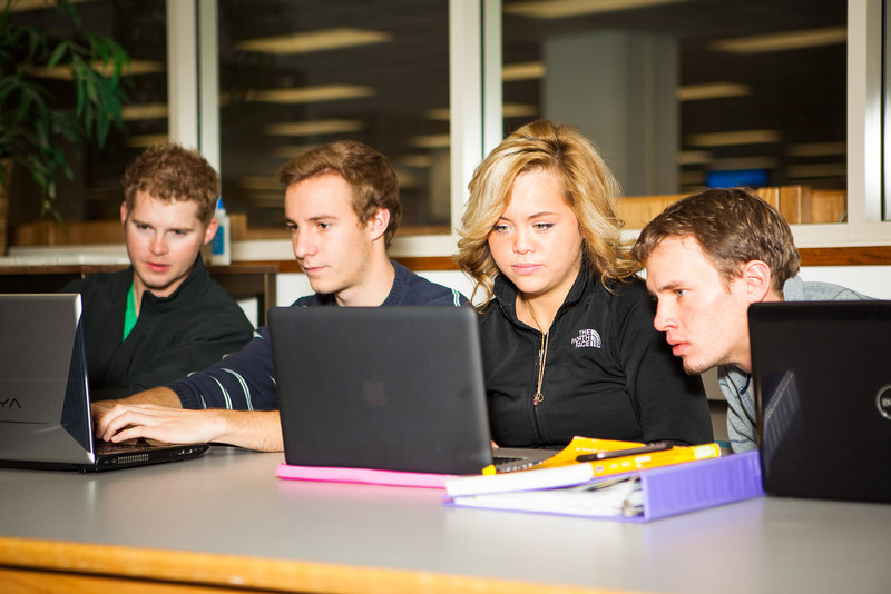 """Business students from left, Girard Gaul, Tobias Keizel, Dani Johnson, and Brian Laurencelle work on their marketting homework Friday, October 5, 2012 at the 23-hour study area at the Rasmussen Library.  <div class=""""ss-paypal-button"""">Filename: AAR-12-3577-2.jpg</div><div class=""""ss-paypal-button-end"""" style=""""""""></div>"""