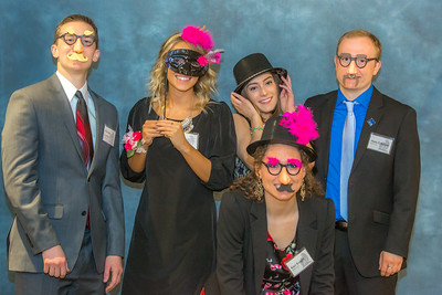 Students in UAF's School of Management clown around in the photobooth before the annual Business Leader of Year banquet in the Westmark Hotel.  Filename: AAR-14-4154-120.jpg