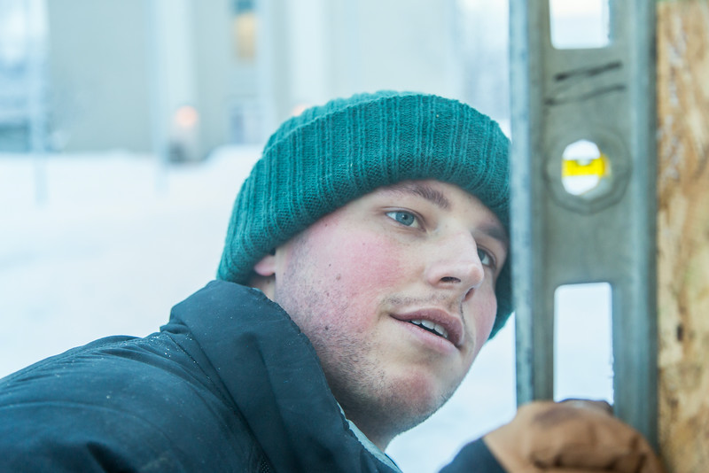 "Engineering major Tripp Collier levels one of the forms used to hold the dome during initial contruction of the 2014 ice arch, a tradition on the UAF campus for more than 50 years.  <div class=""ss-paypal-button"">Filename: AAR-14-4031-8.jpg</div><div class=""ss-paypal-button-end""></div>"