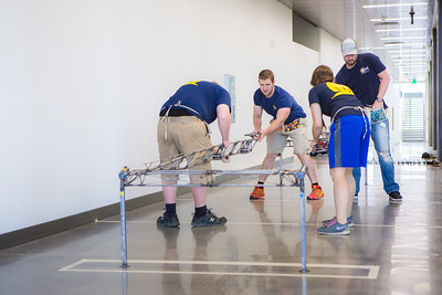 The 2016 UAF Steel Bridge team practices in the hallway of the Duckering Building before competing in the national competition.  Filename: AAR-16-4888-4.jpg