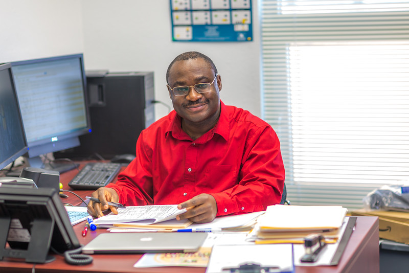 "Assistant Professor of Developmental Math Kelechukwu ""KC"" Alu poses in his office at UAF's Chukchi Campus in Kotzebue  <div class=""ss-paypal-button"">Filename: AAR-16-4863-162.jpg</div><div class=""ss-paypal-button-end""></div>"