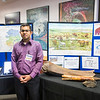 "Santosh Panda stands next to a display on permafrost during the 2018 Lab Open House at the Fairbanks campus.  <div class=""ss-paypal-button"">Filename: AAR-18-5812-37.jpg</div><div class=""ss-paypal-button-end""></div>"