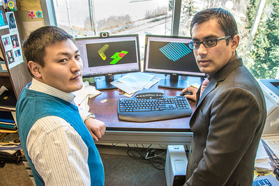 Prof. Rajive Ganguli, right, works with mineral engineering graduate student Erdenebaatar Dondov to study software models of hard rock mine design in his Duckering Building office. Ganguli is helping Dondov and the government in his home country of Mongolia to establish a school of mining engineering there to educate locals to help develop the country's mineral resources.  Filename: AAR-13-3842-35.jpg