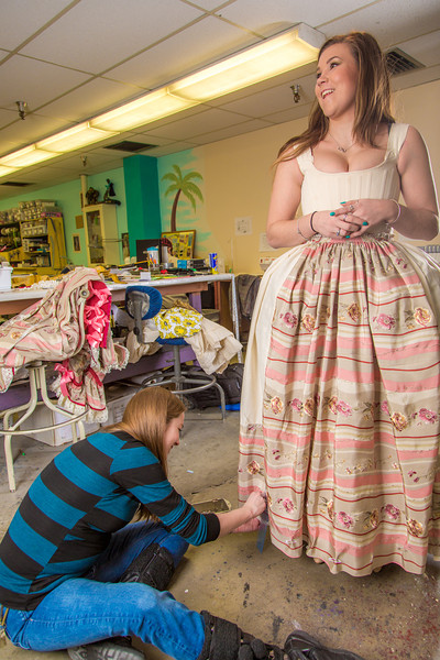"""Assistant professor Bethany Marx marks the hem of a dress worn by theatre major Katrina Kuharich for the Theatre UAF production of Tartuffe in the department's costume shop. Marx designed all the costumes for the show.  <div class=""""ss-paypal-button"""">Filename: AAR-14-4104-69.jpg</div><div class=""""ss-paypal-button-end"""" style=""""""""></div>"""