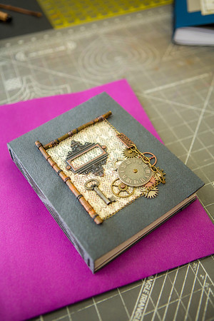 This is one of the completed projects in a custom book binding workshop offered by UAF Summer Sessions during Wintermester 2013.  Filename: AAR-13-3706-63.jpg