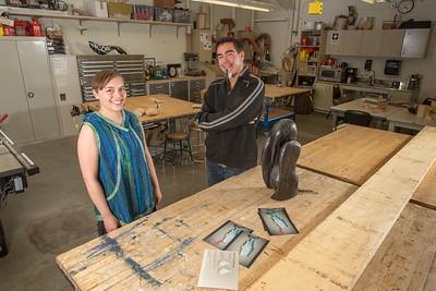 Assistant Professor of Native Arts Da-ka-xeen Mehner visits with 2014 graduate Erin Gingrich visit in his studio in the UAF FIne Arts Complex.  Filename: AAR-14-4354-10.jpg