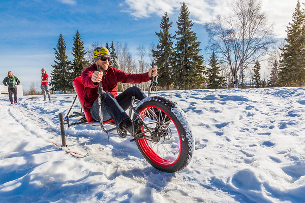 """Mechanical engineering majors Daniel Sandstrom, left, Eric Bookless and Neil Gotschall, front, demonstrate their fat tire ski bike they designed and built for paraplegic users as their spring 2016 senior design project. The bike is powered by pushing and pulling on the handles.  <div class=""""ss-paypal-button"""">Filename: AAR-16-4856-09.jpg</div><div class=""""ss-paypal-button-end""""></div>"""