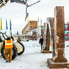 """Engineering students clear the bottom of one of the vertical supports as they raise the 2013 ice arch in Cornerstone Plaza on the Fairbanks campus. Students this year built the structure out of a mixture of ice and sawdust, which is many times stronger than concrete.  <div class=""""ss-paypal-button"""">Filename: AAR-13-3736-151.jpg</div><div class=""""ss-paypal-button-end"""" style=""""""""></div>"""