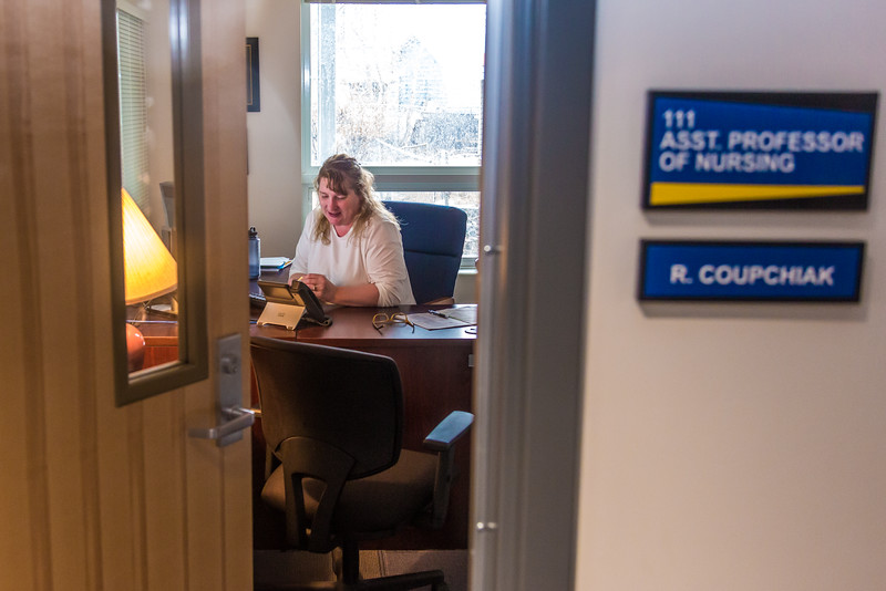 "Assistant Professor of Nursing Becky Coupchiak works in her office at UAF's Bristol Bay Campus in Dillingham.  <div class=""ss-paypal-button"">Filename: AAR-16-4860-468.jpg</div><div class=""ss-paypal-button-end""></div>"