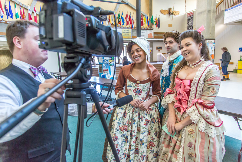 "Nicole Cowans, left, Marley Horner, center and Katrina Kuharich, cast members in Theatre UAF's production of ""Tartuffe"" are interviewed by local media  after performing a live teaser in Wood Center a couple of days before opening night.  <div class=""ss-paypal-button"">Filename: AAR-14-4121-66.jpg</div><div class=""ss-paypal-button-end"" style=""""></div>"