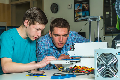 Stephen Ramirez, left, and Daniel Dougherty watch the progress on their project during an open work session in UAF's Community and Technical College's 3-D print lab in downtown Fairbanks.  Filename: AAR-16-4857-011.jpg
