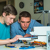 "Stephen Ramirez, left, and Daniel Dougherty watch the progress on their project during an open work session in UAF's Community and Technical College's 3-D print lab in downtown Fairbanks.  <div class=""ss-paypal-button"">Filename: AAR-16-4857-011.jpg</div><div class=""ss-paypal-button-end""></div>"