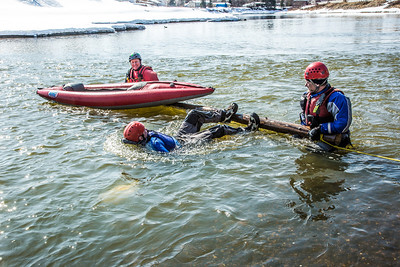 Staff members and graduate students from the Water and Environmental Research Center (WERC) and the Institute of Northern Engineering (INE) receive swiftwater rescue and safety training in the Chena River.  Filename: AAR-13-3813-111.jpg
