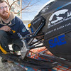 "Mechanical engineering major Isaac Thompson unpacks the snowmobile in front of the Duckering Building after its return from competing in the Society of Automotive Engineers' Clean Snowmobile Challenge in Houghton, Mich.  <div class=""ss-paypal-button"">Filename: AAR-12-3337-07.jpg</div><div class=""ss-paypal-button-end"" style=""""></div>"