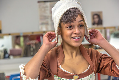 "Theatre major Nicole Cowans gets into her costume before she and other members of the cast of Theatre UAF's ""Tartuffe"" performed a live teaser in Wood Center a couple of days before opening night.  Filename: AAR-14-4121-16.jpg"