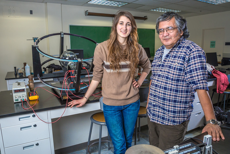"""Physics major Haley Nelson, left, and Stanley Edwin relax after class in a Reichardt Building lab.  <div class=""""ss-paypal-button"""">Filename: AAR-13-4009-94.jpg</div><div class=""""ss-paypal-button-end"""" style=""""""""></div>"""