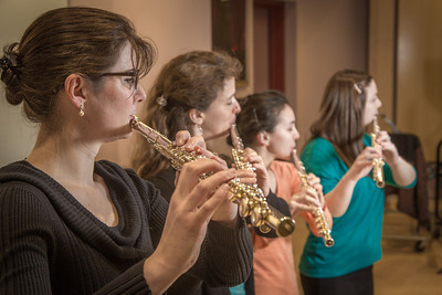 From left to right, Mandi Silveira, Therese Schneider, Meryem Kugzruk and Lilly Gesin are members of a flute quartet at UAF.  Filename: AAR-14-4115-26.jpg