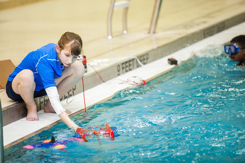 """Middle school students try out their recently built remotely operated vehicles inside the Hamme Pool as part of the Alaska Summer Research Academy.  <div class=""""ss-paypal-button"""">Filename: AAR-13-3861-35.jpg</div><div class=""""ss-paypal-button-end"""" style=""""""""></div>"""