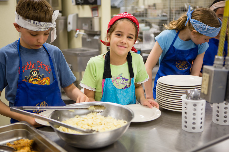 """Students from Summer Sessions' Café Tween pose for a photograph after cooking Italian cuisine at Hutchinson's kitchen.  <div class=""""ss-paypal-button"""">Filename: AAR-12-3432-6.jpg</div><div class=""""ss-paypal-button-end"""" style=""""""""></div>"""