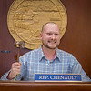 """Uriah Nalikak, a senior in UAF's rural development program from Barrow, has some fun with the gavel moments after posing with Speaker Mike Chenault in the House chambers during a weeklong seminar on understanding the legislative process in Juneau.  <div class=""""ss-paypal-button"""">Filename: AAR-14-4053-163.jpg</div><div class=""""ss-paypal-button-end"""" style=""""""""></div>"""