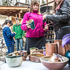 "UAF ceramic students inspect their projects after unloading them from an outdoor kiln fired with recycled vegetable oil.  <div class=""ss-paypal-button"">Filename: AAR-13-3814-37.jpg</div><div class=""ss-paypal-button-end"" style=""""></div>"