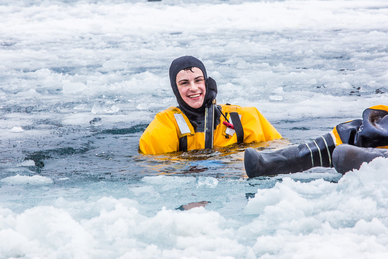 """Student firefighter Joshua Stern has fun practicing cold water rescue techniques in a pond near the Fairbanks campus.  <div class=""""ss-paypal-button"""">Filename: AAR-13-3797-97.jpg</div><div class=""""ss-paypal-button-end"""" style=""""""""></div>"""