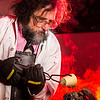 """Geology professor Rainer Newberry pours hot lava over volcanic basalt during a set-up photoshoot in a Reichardt Building lab in on the Fairbanks campus.  <div class=""""ss-paypal-button"""">Filename: AAR-13-3732-30.jpg</div><div class=""""ss-paypal-button-end"""" style=""""""""></div>"""