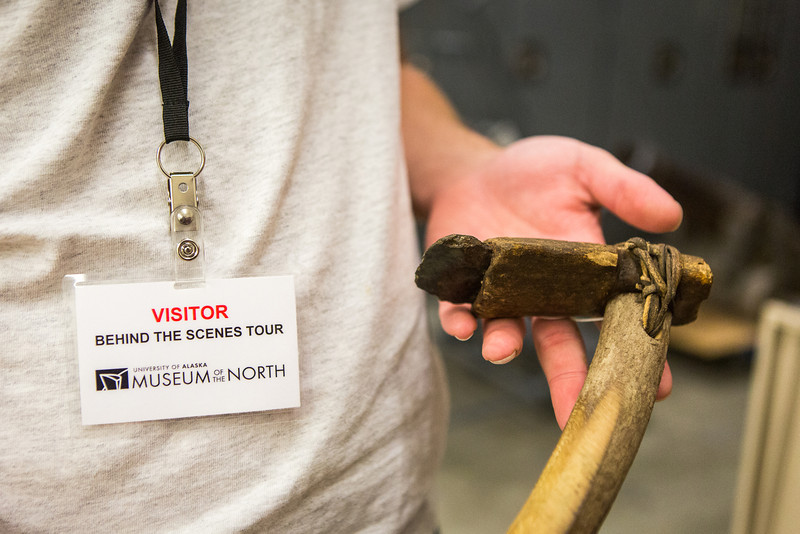 "A visitor takes a closer look at an Alaska Native Artifact during a Behind the Scenes Tour at the UA Museum of the North underground level.  <div class=""ss-paypal-button"">Filename: AAR-13-3905-76.jpg</div><div class=""ss-paypal-button-end"" style=""""></div>"