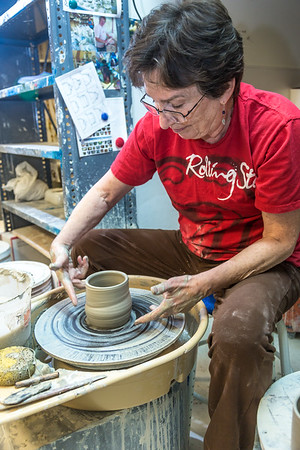 Local instructor Reyne Athanas works on a personal project in the ceramics studio at UAF's Kuskokwim Campus in Bethel.  Filename: AAR-16-4859-634.jpg