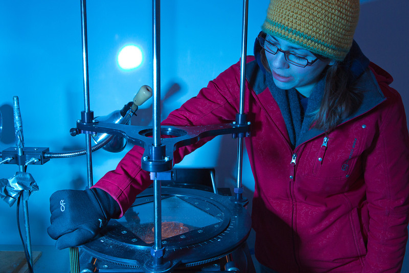 "Sophomore Tiffany Green inspects crystal formations in a thin slice of ice in the Elvey Building ""Cold Room"" during a lab exercise in her Ice in Climate Systems class.  <div class=""ss-paypal-button"">Filename: AAR-12-3330-097.jpg</div><div class=""ss-paypal-button-end"" style=""""></div>"