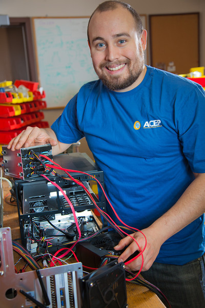"""Graduate student Richard Stevens works on components of a desktop computer in the workshop of the Alaska Center for Energy and Power on the Fairbanks campus.  <div class=""""ss-paypal-button"""">Filename: AAR-11-3245-48.jpg</div><div class=""""ss-paypal-button-end"""" style=""""""""></div>"""