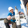 "Associate Professor Mat Wooller tests a new vibra-coring system through a hole in lake ice to sample long cores of sediment deep below the lake's bottom.  <div class=""ss-paypal-button"">Filename: AAR-12-3346-031.jpg</div><div class=""ss-paypal-button-end"" style=""""></div>"