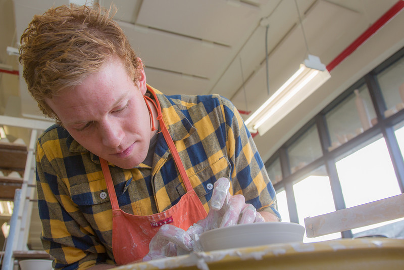 "Art major Ian Wilkinson works on one of approximately 1,000 ceramic bowls needed for his senior thesis project in the fine arts complex on the Fairbanks campus.  <div class=""ss-paypal-button"">Filename: AAR-12-3547-029.jpg</div><div class=""ss-paypal-button-end"" style=""""></div>"