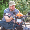 "Carl France with the Alaska Center for Unmanned Aircraft Systems Integration (ACUASI) sets up a piloting station on a gravel bar along the upper Chena River. The UAV pilot was taking part in a joint effort with the U.S. Fish and Wildlife Service to collect video of important king salmon spawning habitat.  <div class=""ss-paypal-button"">Filename: AAR-15-4593-118.jpg</div><div class=""ss-paypal-button-end""></div>"