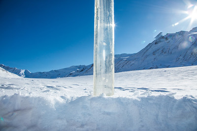 A coring tube protrudes through the snow on the surface of the Jarvis Glacier. A UAF research team is nvestigating future flow in rivers coming directly from glaciers, as bridges and road networks can be affected by varying water levels.  Filename: AAR-13-3795-694.jpg