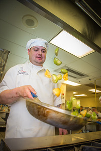 Joshua Broda prepares squash to serve during lunch at CTC's culinary arts kitchen in the Hutchison Center.  Filename: AAR-13-3811-91.jpg