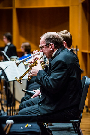 Members of the UAF Wind Symphony warm up prior to their concert on Nov. 18, 2016.  Filename: AAR-16-5070-54.jpg