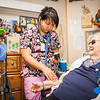 "Nurse Aid Training student, Justice Raymond, checks resident Juanita Cowells's vital signs during a two-week clinical practicum at the Denali Center in Fairbanks.  <div class=""ss-paypal-button"">Filename: AAR-13-3859-135.jpg</div><div class=""ss-paypal-button-end"" style=""""></div>"