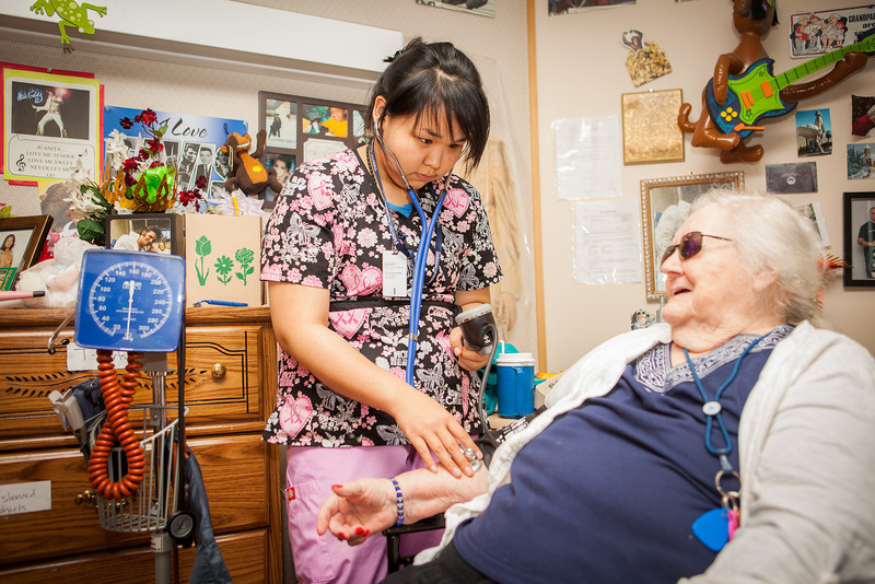 """Nurse Aid Training student, Justice Raymond, checks resident Juanita Cowells's vital signs during a two-week clinical practicum at the Denali Center in Fairbanks.  <div class=""""ss-paypal-button"""">Filename: AAR-13-3859-135.jpg</div><div class=""""ss-paypal-button-end"""" style=""""""""></div>"""