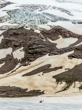 A helicopter provides access for a team of UAF researchers gathering data from the surface of the Jarvis Glacier in the eastern Alaska Range.  Filename: AAR-14-4256-241.jpg
